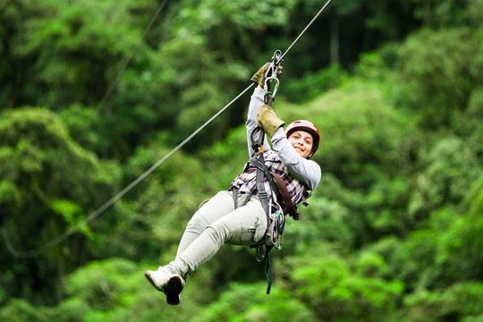 zip line ziplin wire canopy people normal rope jungle forest zipline sport climbing mature pioneer wear casual suit on zipline trip selective focus versus hazy timber