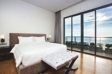 Modern comfortable, nicely decorated bedroom with seascape view