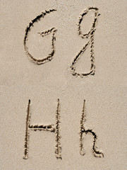 Sand font or letter set or collection on an exotic beach near the sea in summer