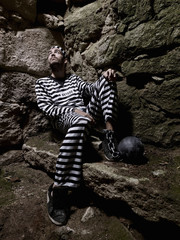 Prisoner in a jail, with the steel ball and looking up