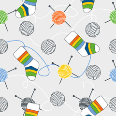 vector seamless pattern with ball of threads and socks