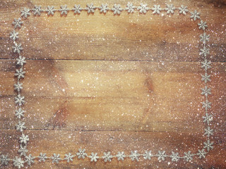 image of christmas festive decoration on wooden background. retro filtered