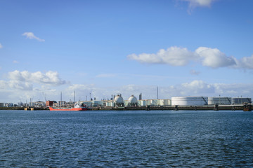 Oil refinery industry with oil storage tanks in the port of Nort