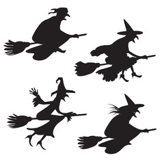 Set of four silhouettes of flying witches