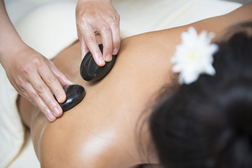 massage with hot black stone by therapists