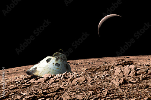 Wall mural A harsh alien landscape is the crash site of a space capsule. - Elements of this image furnished by NASA.