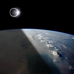 Fototapete - Eclipse from Above - Elements of this image furnished by NASA.
