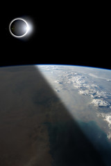 Eclipse from Above - Elements of this image furnished by NASA.