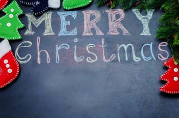 Merry Christmas written with chalk on a black background