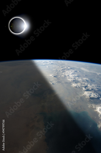 Wall mural Eclipse from Above - Elements of this image furnished by NASA.
