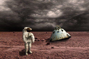 A marooned astronaut surveys his situation - Elements of this image furnished by NASA.
