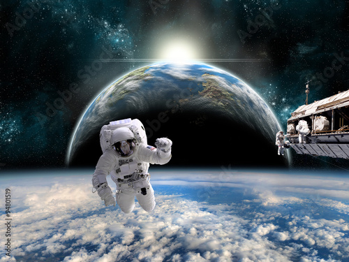Wall mural A team of astronauts work on a space station - Elements of this image furnished by NASA.