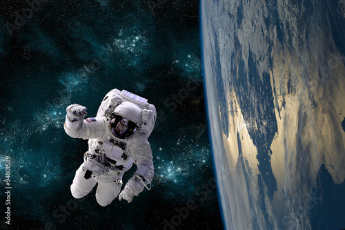 An astronaut floats in the zero gravity environment of space