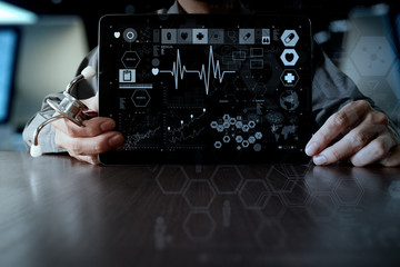 Medicine doctor hand working with modern computer interface and