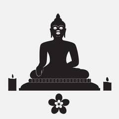 Black silhouette of Buddha with candle and flower