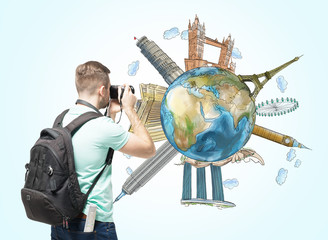A tourist shoots the globe with sketched famous places. Light blue background. Elements of this image furnished by NASA.