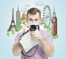A front view of the handsome tourist with camera. Drawn sketches of the most famous touristic places on the light blue background. The concept of tourism and sightseeing.
