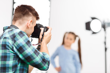 Young photographer is busy during photoshoot.