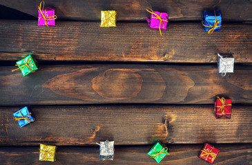 Boxes with gifts on a dark wooden boards