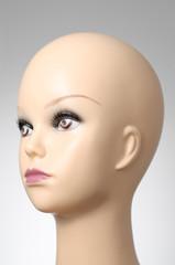 Mannequin head on grey background