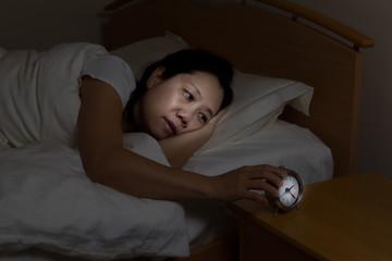 Mature woman restless at night time