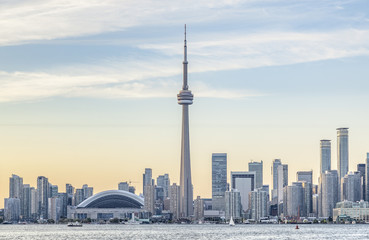 Toronto skyline with the CN Tower apex at sunset.