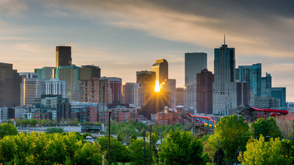 Sunrise peeks through the skyline of Denver