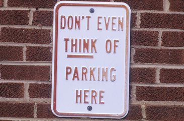 A sign that reads ÒDon't even think of parking hereÓ