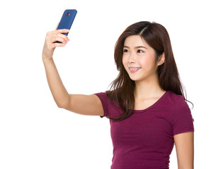 Asian Young Woman take selfie by cellphone
