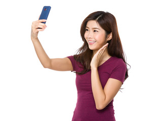 Asian Woman take photo by herself by mobile phone