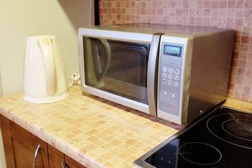 Electric kettle and microwave oven in the kitchen environment