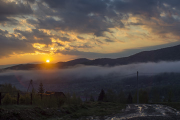 Daybreak in autumn Carpathian mountain village outskirts, Ukraine.
