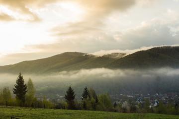 Daybreak in autumn Carpathian mountain village outskirts, Ukraine.
