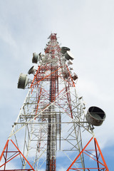 Telecommunication tower with a sunlight. Used to transmit television signals.