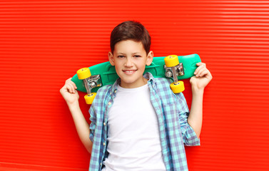 Portrait happy smiling teenager boy wearing a checkered shirt wi