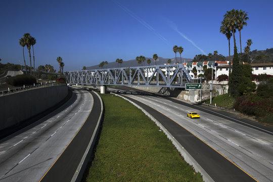 Yellow Corvette drives Route 101 at California Avenue, Ventura, California, USA, 01.29.2014