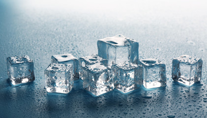 Melting ice cubes with drops around, close up