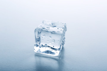 Concept of perfection - ice cube on grey background