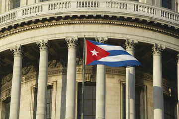 The Capitolio and Cuban Flag, the Cuban capitol building and dome in Havana, Cuba