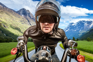 Wall Mural - Biker racing on the road