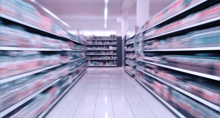 Empty supermarket aisle.  Motion Blur.