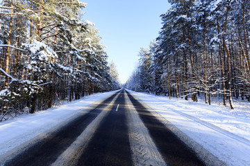 winter road .  snow