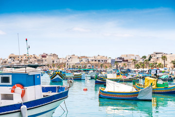 boats in Marsaxlokk harbor Wall mural