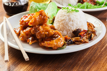 Chicken pieces with rice and sweet and sour sauce
