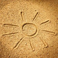 Sonne am Strand im Sand