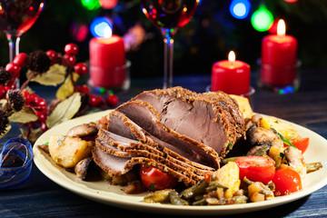 Juicy roast pork on the holiday table