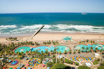 Aerial view of Indian Ocean, white sandy beaches, pool and ocean pier in the town center of Durban, South Africa