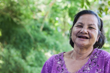 Old thai woman in garden