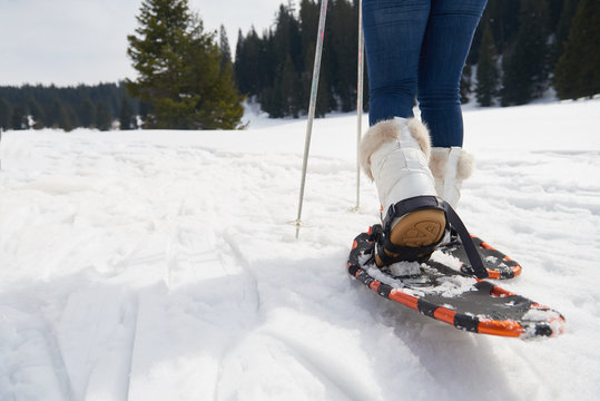 couple having fun and walking in snow shoes