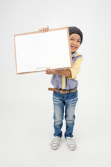 Happy Asian boy holding art board
